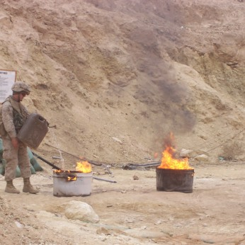Somewhere some poor bastard has it worse than you. A Marine burns shit in Haditha, Iraq, December 2006.