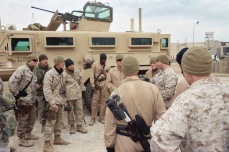 Staff Sergeant Lange briefs his Marines before a patrol to find IEDs on a cold winter day in Haditha, Iraq. I love everyone of those kids. 2006