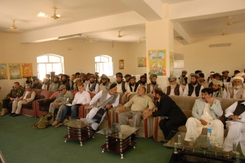 Afghan elders await a session with Americans and Afghans from Kabul to begin in the summer of 2009. Zabul Province, Afghanistan.