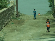Sunni boys come running as we drive past. They always came running. It would scare the hell out of you because we were always capable of being attacked or hitting an IED. My stomach sinks now as my body and mind remember kids like this running towards us and being so afraid, so afraid, they would be killed.