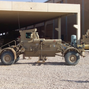 One of my Huskies. You placed a Marine inside of this vehicle and he drove along the road with metal detectors under the vehicle. Its modular design allowed it to be blown to pieces without the Marine suffering visible wounds, usually. Of course, a minor design flaw was that the detector was behind the front wheels. My Marines drove these vehicles daily looking for bombs in and on the side of the roads. They never complained.