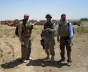 Checking on the status of road work in southeastern Afghanistan. Summer 2009.