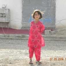 A young girl in Qalat, Zabul Province Afghanistan. At her age she has only a few years remaining of being outside, not covered, and not escorted by a male relative. When she reaches puberty she will be shut away with the remainder of the female members of her family until she is married off to start a family of her own. If she is lucky she will be a first wife.