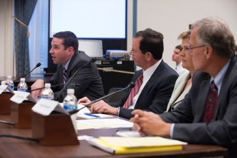 Speaking to members of Congress in July 2010. Bob Pape of the University of Chicago is beside me.