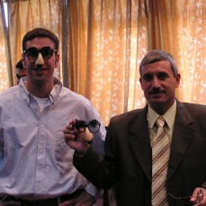 With my friend, General Abdullah. He wouldn't wear the glasses because he didn't want his enemies to see him in them. His enemies executed him in April 2011.