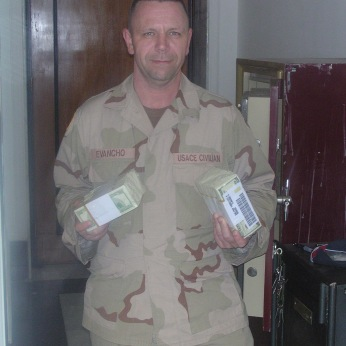 Brian, one of our Army Corps of Engineers civilians with some cash from one of my safes. Tikrit, Iraq, 2004/5