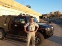 My first and, only, boss, Chuck, in Tirkit, posing in front of an armored Humvee on FOB Danger.   The rumor was that that vehicle had belonged to Michael Jackson. I don't know if that is true, but what is true is that the US government and its allies were incredibly unprepared for the war in Iraq. Over a year of believing it would get better in Iraq by politicians, bureaucrats and generals finally evaporated and in 2004 the US government purchased and requisitioned armored vehicles across the world to protect its people in Iraq.  If I recall right this vehicle was delivered without the keys. Eventually KBR came and took it away.