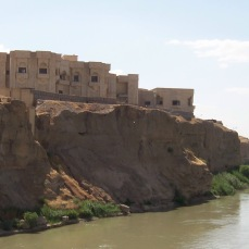 The 1st Infantry Division Headquarters in Tikrit, Iraq. Named FOB Danger, we were housed in an extremely large compound built by the Baath Party in Tikrit, Iraq. With dozens of palaces and villas, manmade lakes and waterfalls, and a zoo, it was an absurdist realization of a fever dream combining Disneyworld, Las Vegas, and the sets of Elizabeth Taylor's Cleopatra. The division headquarters, pictured here, was located on the cliff overlooking the Tirgis River where, according to legend, the great Muslim general Salahaddin was born. By the time I left we had a trailer selling Subway sandwiches, a coffee shop where Bangladeshi workers would make you a cappuccino and Zumba classes.