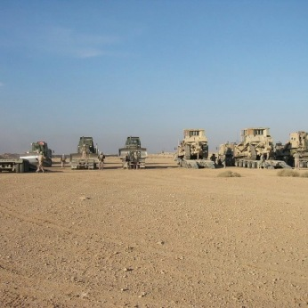 Heavy equipment from my engineer task force getting ready to drop and berm a city in western Anbar Province, Iraq in November 2006. My task force was composed of nearly 300 Marines, Sailors and Soldiers and 100 pieces of rolling equipment, including nearly 50 pieces of engineer equipment. I was later told I had commanded the largest Marine Corps engineer operation of the Iraq War. Within a few years I would not be able to hold a job for more than a few months at a time.