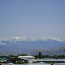 Tora Bora seen from Jalalabad Airfield in Spring 2005, Northeastern Afghanistan. These were the mountains that bin Laden and his few remaining allies escaped to in 2001. From here he escaped into Pakistan. When I took this photo in 2009 I thought what would have happened if we had got bin Laden in 2001. If we had captured or killed him in those mountains. How different would history be, how different our lives, how many lives would not be devolving in the ground, how many dreams and promises to love ones would have been kept? Over four years after killing bin Laden our wars continue. The same would have occurred in 2001. We were a nation bent on war and once entered into war, by petty men and women devoid of worldly, historical, cultural and religious knowledge, but conditioned to obey the campaign dollars and the public opinion polls., We always surrender our options and free will to the gods of war. The Romans and the Greeks named forces outside of human control as gods. Chief among the gods were Mars (Rome) and Ares (Greece). Such a god still exists as war, a force beyond human manipulation, control or understanding. Ask the dead in Paris, Beirut, the Sinai, Raqaa, Baghdad and Kabul if they disagree.