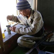 A guard stirs the tea he made for me with the cleaning rod from his rifle. Qalat, Zabul Province, Southern Afghanistan, May 2009