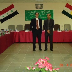 With Karzan at a meeting of generals and governors in Sulimania, Kurdistan, Iraq, April 2005. Note the photo of Talabani and the Kurdish flag.
