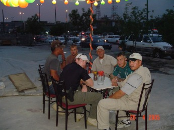 My security team at an outdoor restaurant in Sulimania, Kurdistan. Sit outside, smoke cigs, talk to people and be nice. Heading to Kurdistan, with a stop first in Kirkuk, every six weeks was like R&R.