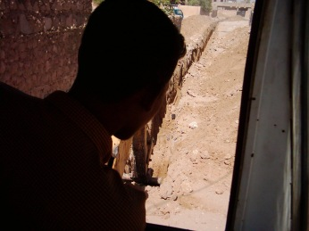 A young Iraqi digs a ditch in Salah ad Din province in 2004 or 2005.