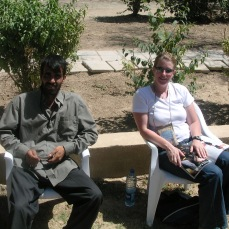 A co-worker attracts attention while supervising day laborers on the CPA grounds. Spring 2004. Green Zone, Baghdad. Our women got lots of attention from local men not used to form flattering clothing.