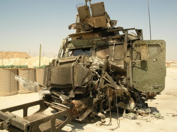 One of my 7-ton trucks post IED strike. My three Marines walked away from this, but were never tested for traumatic brain injury upon returning home to the US. Upon getting home we did receive a one hour PTSD briefing from a kind person who had never been to war. We didn't give it much mind. 2007