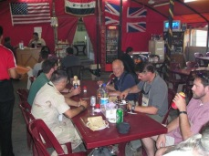 Drinking and eating at the Green Zone Cafe in Baghdad in September 2004, obviously before the suicide bomber hit it.