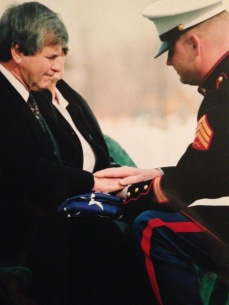 My friend Sean delivers the flag to his father at Sean's brother's funeral.