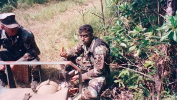 One of my best friends in Okinawa with an MRE hot dog. 2000.