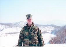 First Lieutenant Hoh with North Korea behind him in the winter of 2001.