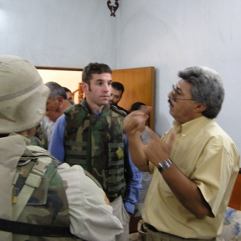 Speaking with a local municipality engineer during post combat operations in either Samarra or Bayji, Fall 2004. I have no excuse for the sideburns. It was a tough time for us all...