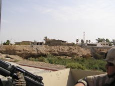 A view of Iraq from an open Humvee. This photo would have been from the Fall of 2004. A year and a half after the invasion we were still operating in vehicles open and exposed to enemy gunfire, rockets and IEDs, while welding our own armor onto the vehicles for protection.