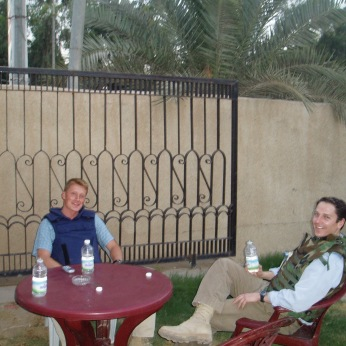 At an outdoor restaurant in the Green Zone. By 2004 Western staffers were unable to leave the Green Zone, safely, without armed escort, and going to dinner in one of Baghdad's many restaurants was impossible. Rocket and mortar fire were common in Baghdad, so wearing body armor during a dinner out, in one of the restaurants and bars that existed within the confines of the Green Zone, was often seen as a minor inconvenience.