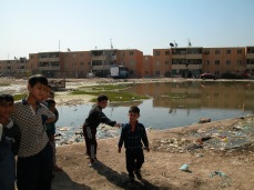 Young Shia boys gather outside their homes in Sadr City, Baghdad in 2004 or 2005. By now these boys are old enough to fill out the ranks of the Shia militias or the Shia dominated Iraqi Army. That is if they were lucky enough to survive the last decade. A decade that has seen nearly one million Iraqi deaths.