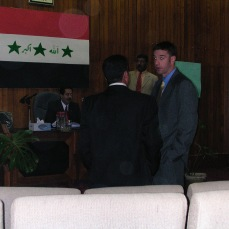 Attending the weekly Salah ad Din Provincial Council meeting in 2004 or 2005. The provincial council chairman (seated beneath the flag) would be killed not very long after I left Iraq. The man I am talking to is my friend, Khaled, the provincial head of construction, I have no idea if he is alive. In my suit pants pocket would have been my .32 Llama pistol.
