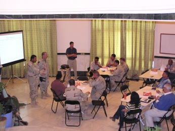 A joint Iraqi-US reconstruction team meeting. Anyone who tells you we weren't doing counter-insurgency prior to General Petraeus' assumption of command in Iraq in 2007 simply doesn't know what they are talking about. Here we were utilizing millions and millions of dollars in American resources and money in collaboration with Iraq institutions, norms and personnel. Yet, every week, the insurgency grew stronger. A well financed and charitable occupation is still an occupation.