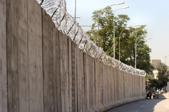 T walls and concertina lined the roads in the Green Zone (GZ). I was first stationed in Baghdad in spring 2004 before moving north to Tikrit, but I returned to the embassy roughly every 6 weeks. Each time I returned to the GZ more fortifications, barricades and obstacles had been constructed. Yet, inside the Embassy, assessments of Iraq were rosy...